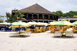 sun beds and parasols on Labadi beach Ghana